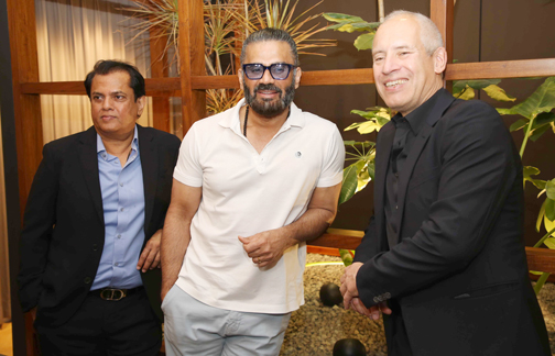 Bollywood actor Suniel Shetty poses for a picture during the store launch of 'GM-Occhio'