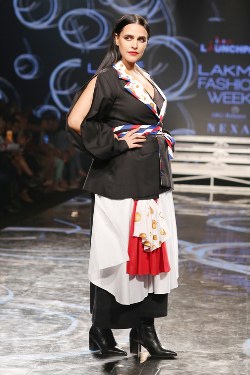 Bollywood actress Neha Dhupia showcases a creation by designer itishree satpaei at the Lakmé Fashion Week (LFW)