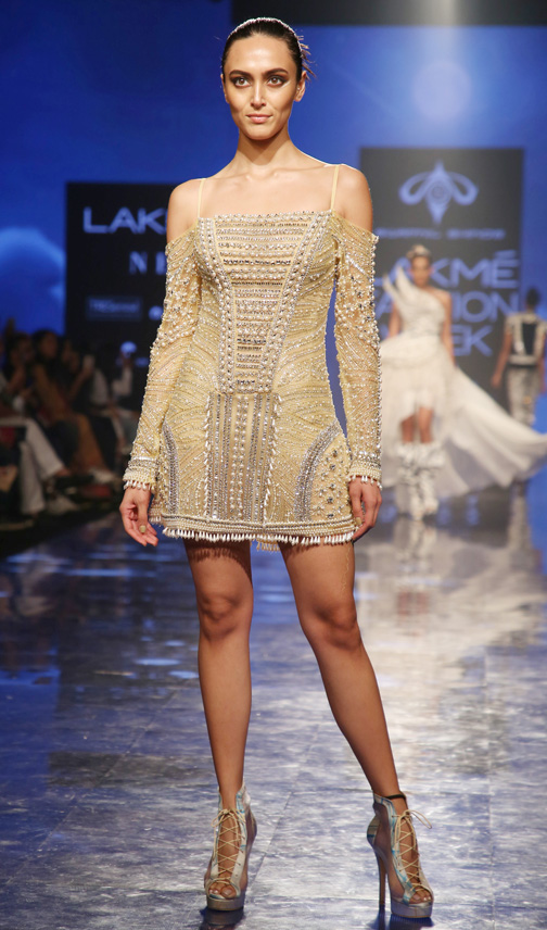 Bollywood actress Sunny Leone showcases a creation by designer Swapnil Shinde